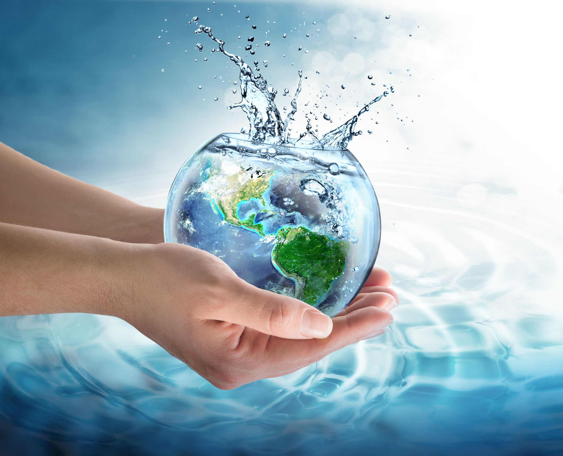 hands holding a globe of water